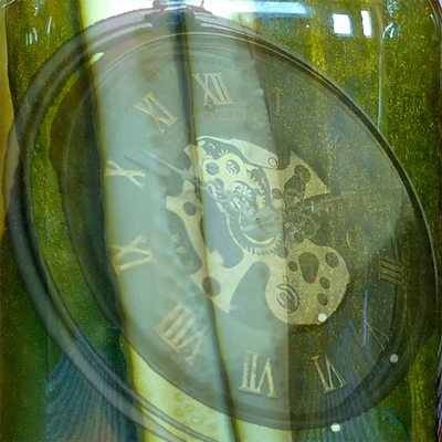 A jar of pickles with a pocket watch inside