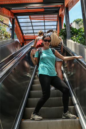 Kylee riding one of the escalators of Comuna 13