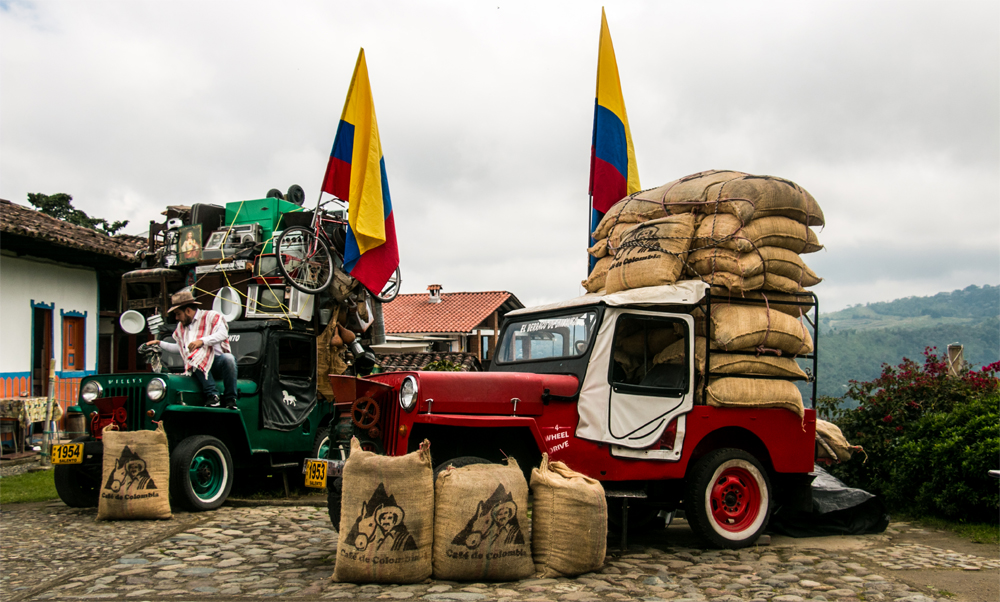 Two jeeps, loaded with coffee and supplies. Probably not the best method to get from Salento to Bogota