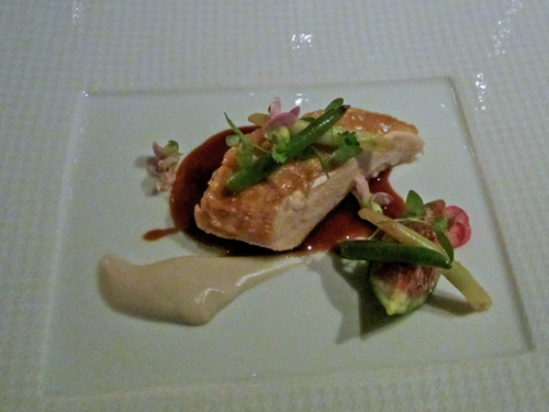 A chicken roulade with vegetables and sauce