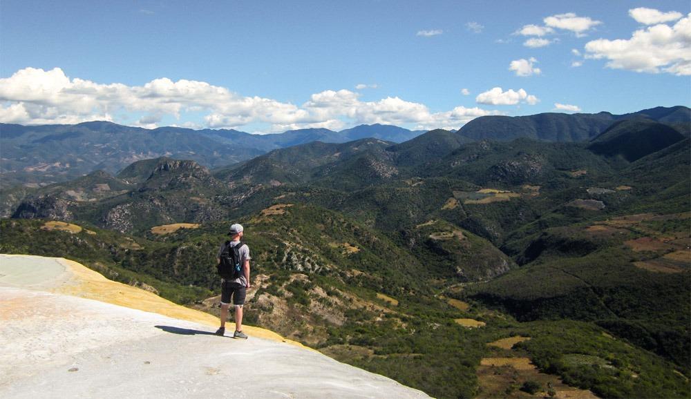 Mark looking at the green valley below Hierve el Agua
